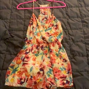 Everly floral romper - never worn